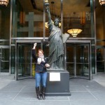 Holly and the small model of the Statue of Liberty